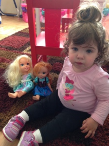 baby with frozen dolls